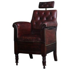 19th Century English Oak Adjustable Maroon Buttoned Leather Barbers Chair