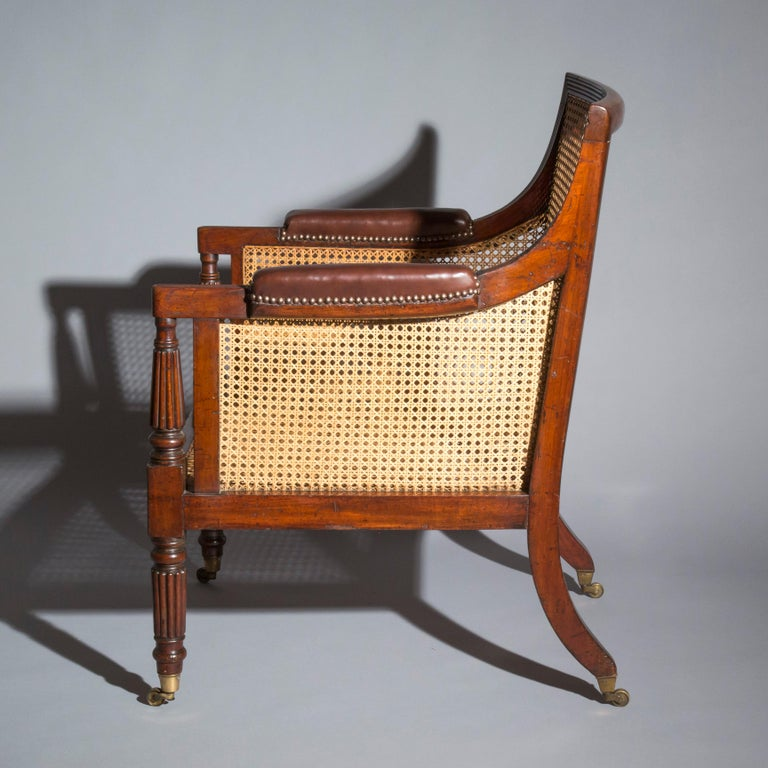 A superb early Regency period library bergère armchair in mahogany, attributed to Gillows of Lancaster and London.