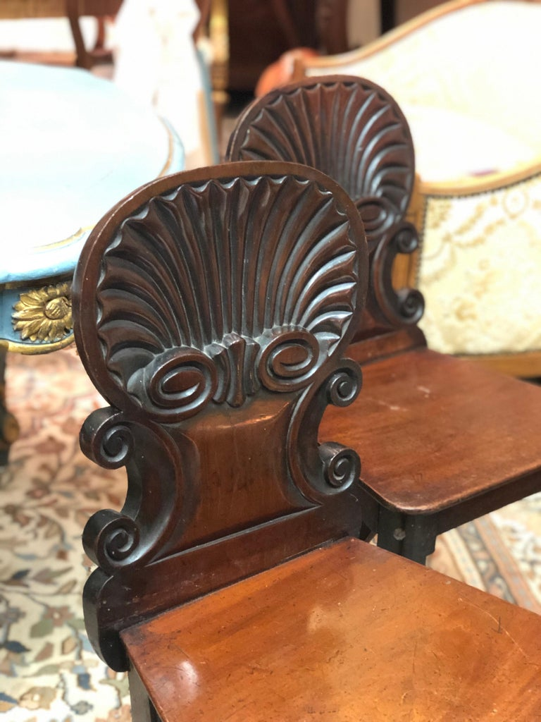 Hand-Carved 19th Century English Regency Hand Carved Mahogany Hall Chairs For Sale
