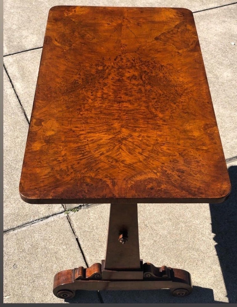 19th century English Regency sofa table. Beautiful tropical hardwood top over single drawer. Original casters.