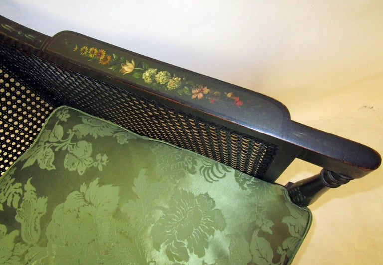 Fruitwood 19th Century English Regency Bergere Chair Painted Ebonized Wood and Cane  For Sale