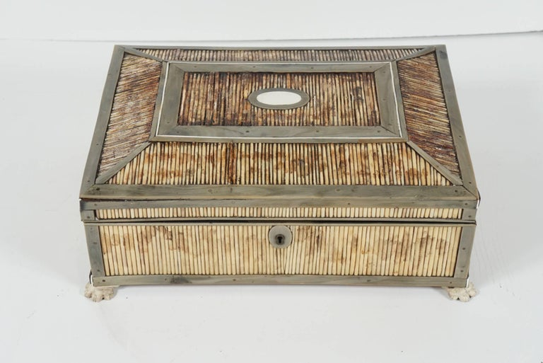 This lovely fine old box was made in India or Asia as a trade item designed specifically for exportation to the English Colonial trade. Crafted between 1815 and 1840 in a time honoured form. The box is made of sandalwood veneered in horn that has