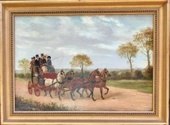 19th century Victorian English mail coach with horses in a landscape