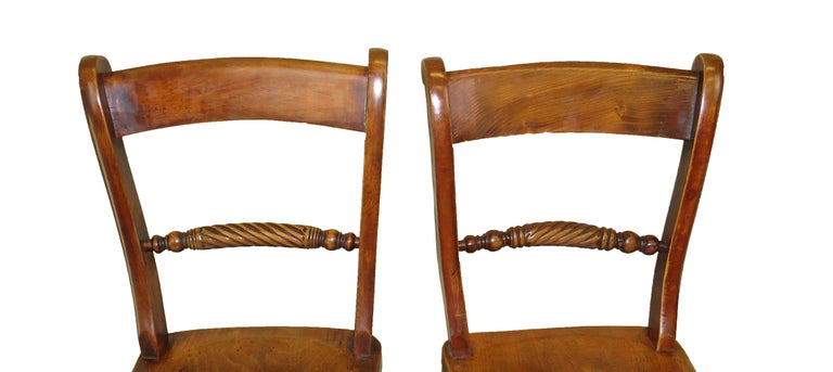 A charming set of eight mid-19th century beech and