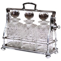19th Century English Silver Plated Three-Carafe Bar Tantalus with Lock Mechanism