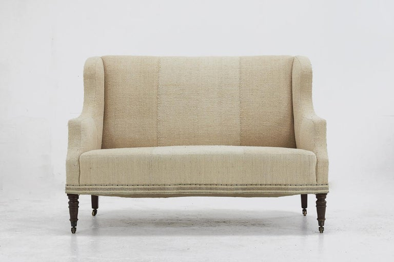 Nice proportion, 19th century English sofa. Upholstered in antique fabric. Measures: Seat height 43 cm Seat depth 62 cm.