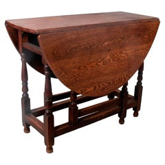 19th Century English Spindled Leg Winged Wooden Table