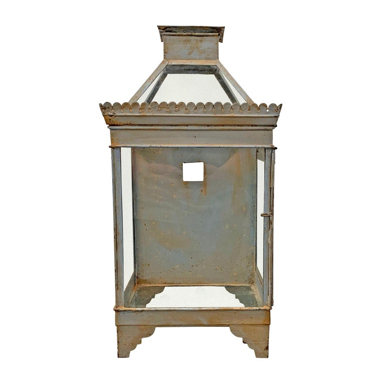 A charming 19th century English blue painted tole wall mount lantern of with a clearstory top that opens, and a door on the side that also opens for access. The square hole in the back was originally used to hang the lantern, but can be used to