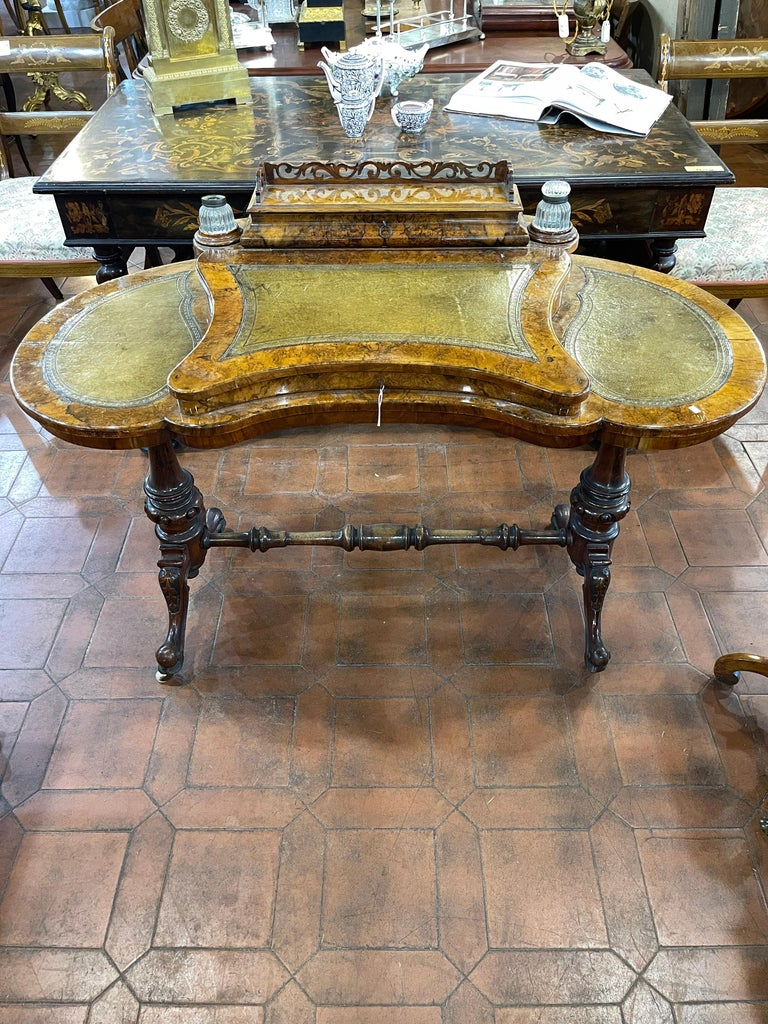 Victorian burr walnut kidney shaped ladies writing table. Fantastic example of an English ladies desk writing table, from the early Victorian period.Fantastic quality walnut burr wood ,with leather on the top still original. In the central part of