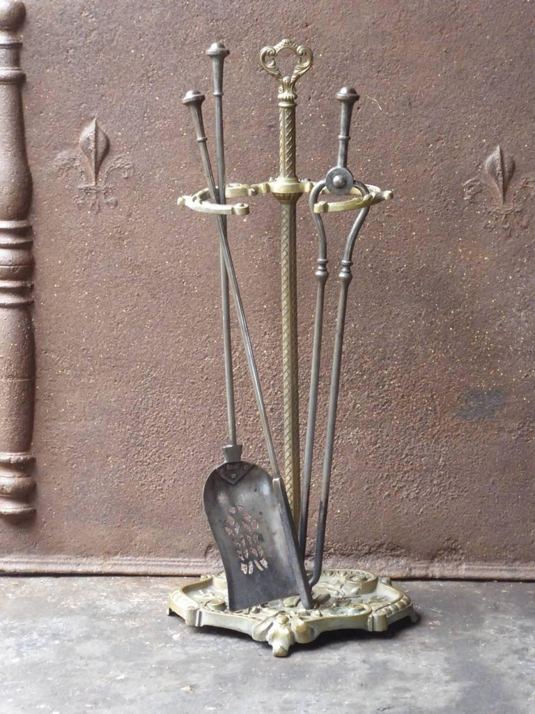 19th century English Victorian fireplace tool set - fire irons made of wrought iron and brass.  We have a unique and specialized collection of antique and used fireplace accessories consisting of more than 1000 listings at 1stdibs. Amongst others,