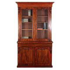 19th Century English Victorian Figured Mahogany Bookcase with Carved Details