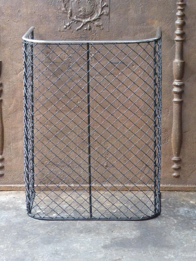 19th century English Victorian fireguard - fireplace guard made of polished steel, iron and iron mesh.