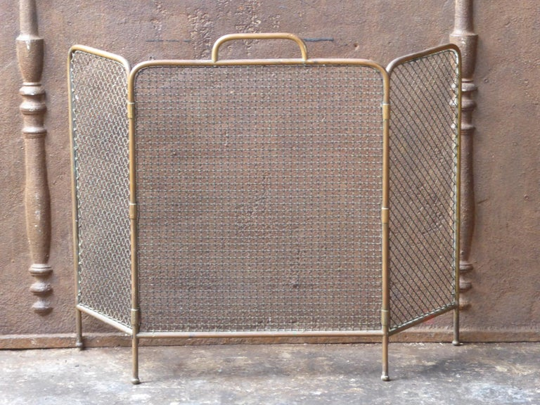 19th century English Victorian fireplace screen made of brass.