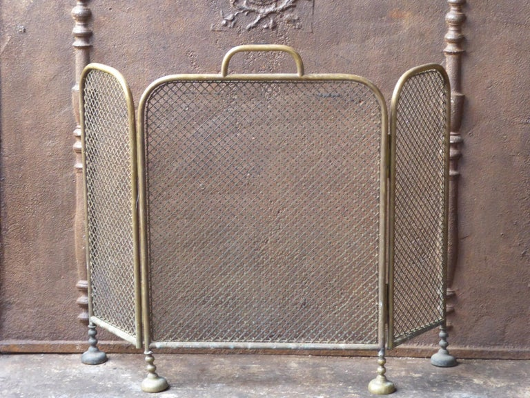 19th century English Victorian fireplace screen made of brass and iron mesh.