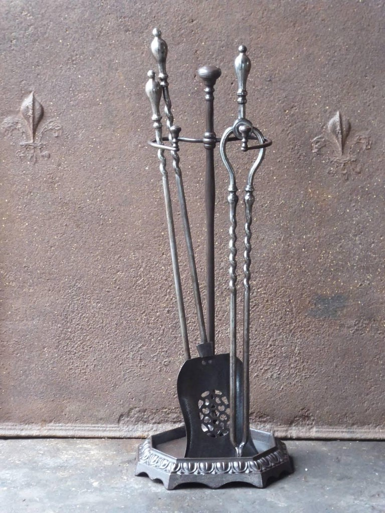19th century English Victorian fireplace tool set, fire irons made of cast iron and wrought iron.  We have a unique and specialized collection of antique and used fireplace accessories consisting of more than 1000 listings at 1stdibs. Amongst