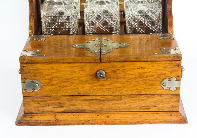 Silver Plate 19th Century English Victorian Oak Three Crystal Decanter Tantalus  For Sale