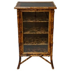 19th Century English Victorian Tiger Bamboo Lacquer Cabinet with Gilt Wallpaper