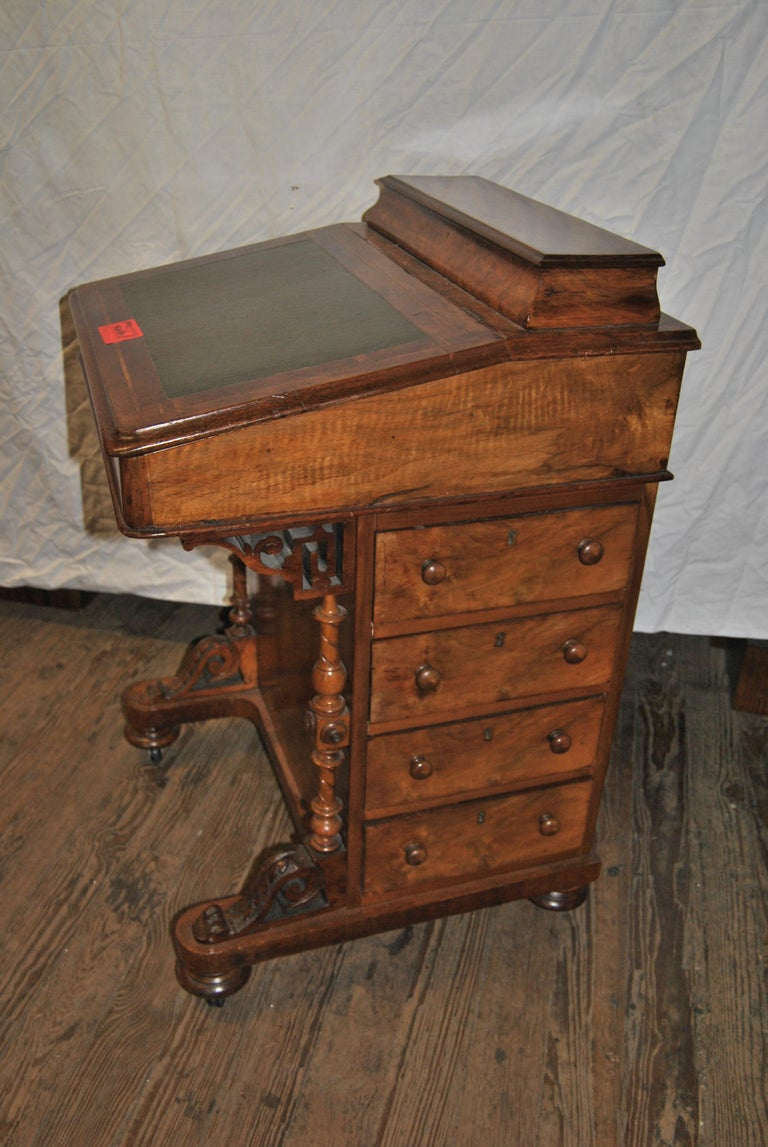This is a Walnut Inlaid Davenport Desk made in England, circa 1870. The top gallery has a nicely molded edge and opens to reveal 10 open cubby holes / dividers for storage of paper, pens, Ink Wells, etc. The Green Leather Top writing surface also