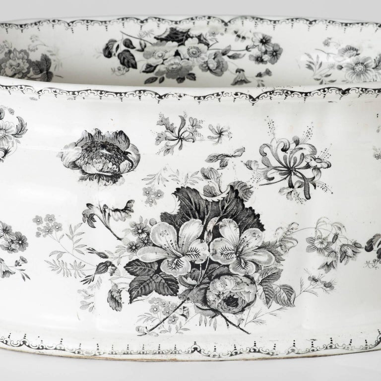 """The monochrome colorings of this English transferware foot-tub give it a unique, one-of-a-kind look. The pattern name is stamped on the reverse and is called """"Woodbine."""" Flower decorations line the interior as well, circa 1850.  Measures: 8"""""""