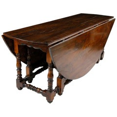19th Century English Yew Wood Drop-Leaf Gate Leg Dining Table