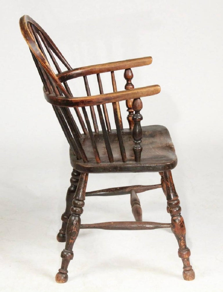 19th century rustic English bow-back Windsor chair; yew wood, bentwood and spindle back, pierced centre splat, turned supports for arms, bodged seat.   *Typical of the chairs made in or near High Wycombe before making Windsors there became factory