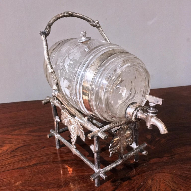 19th century etched glass liquor barrel on a silver plated stand. The stand ornamented with grapes and leaves.