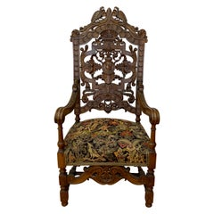 19th Century European Carved Walnut Arm Chair with Tapestry Upholstery