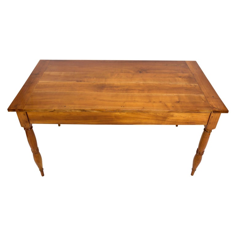 Farmer's table made of solid cherrywood from the late Biedermeier period, circa 1850 from southern Germany. The table has two drawers, one on each short side. The distance from the floor to the frame is 61.5 cm. The table is in a very well