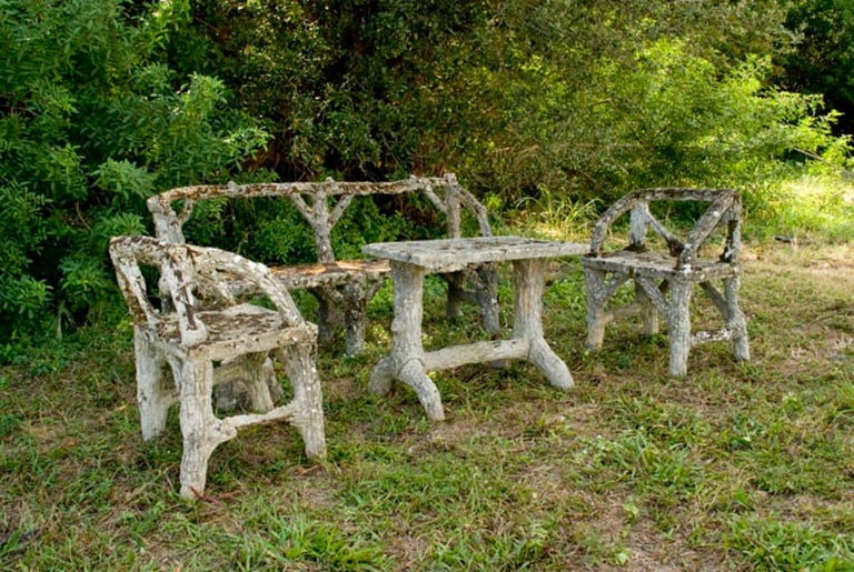 An antique garden set composed of one, two-seat bench, two chairs and a rectangular table. All surfaces are covered with grown moss and lichen which adds the charm of centuries to this very rare garden furniture. The set has minor damages. Wear