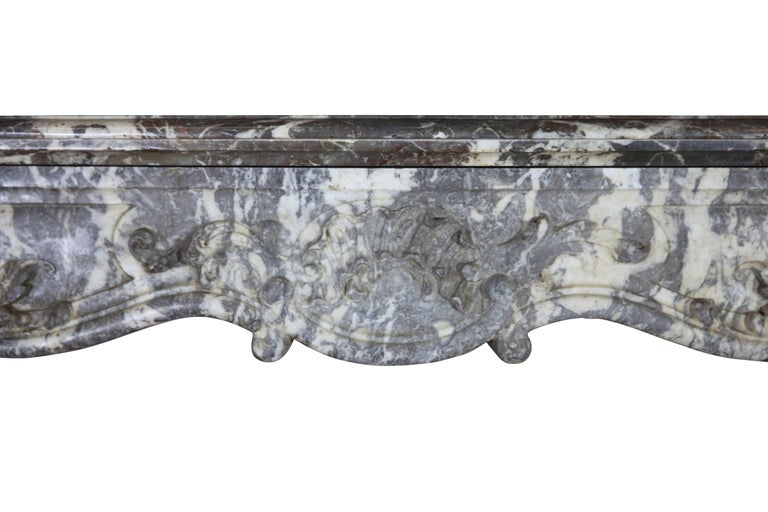 """This 19th century marble fireplace surround is very unique and in perfect condition. Its lines and its form have very nice movement. Very pure for a bespoke and elegant interior. Measures: 166 cm EW 65.35"""" 114 cm EH 44.88"""" 120 cm IW 47.24"""" 97"""