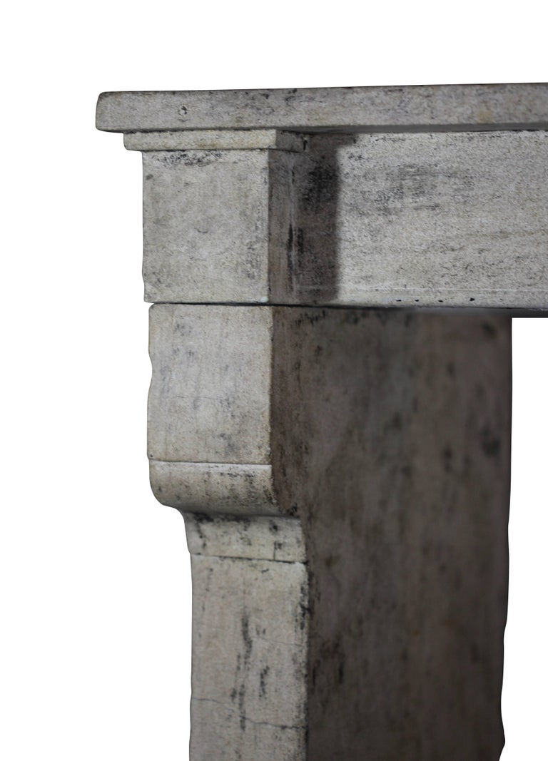 This is a Limestone fireplace mantel (fireplace) with remains of the original patina. It is simple and straight with several nice details. The vintage paint, patina can be removed on demand.  Perfect architectural element for a French Rustic timely