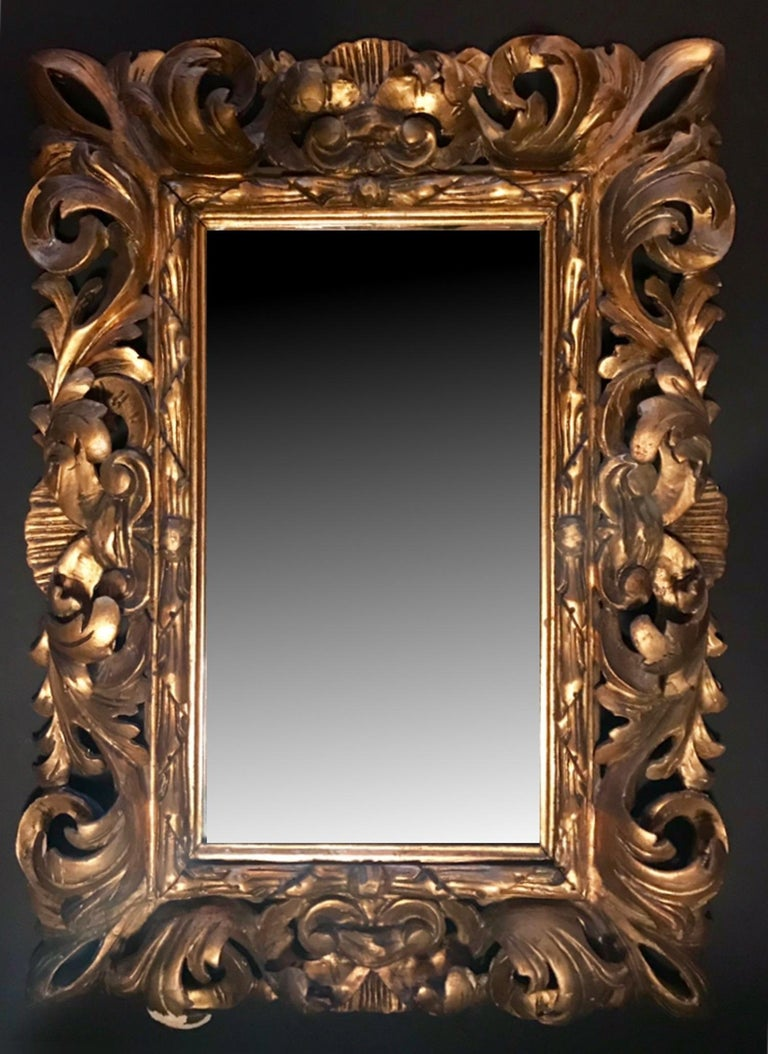 This is a beautiful hand carved and gilded mirror frame. It is a dramatic wall hanging with a stunning depth of more than 3 inches. The circa 1880 Baroque style frame was created in Florence, Italy. The gilt is original to the period and has