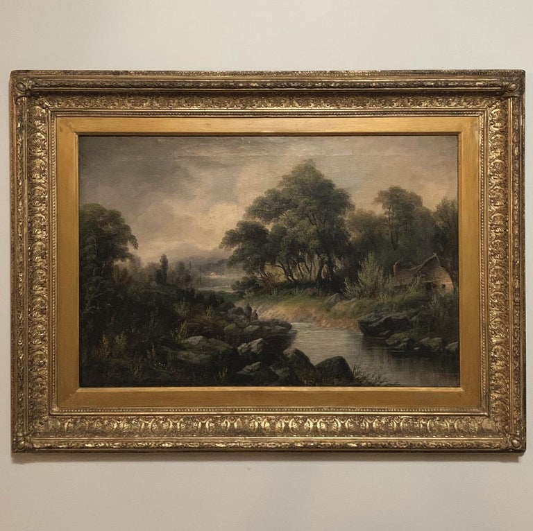19th century framed oil painting on canvas by H. Brooks is a superbly rendered landscape in the rustic genre, with a quaint cottage by the water's edge and a cloudy sky moving in from the left. Survives in its original intricate frame, circa
