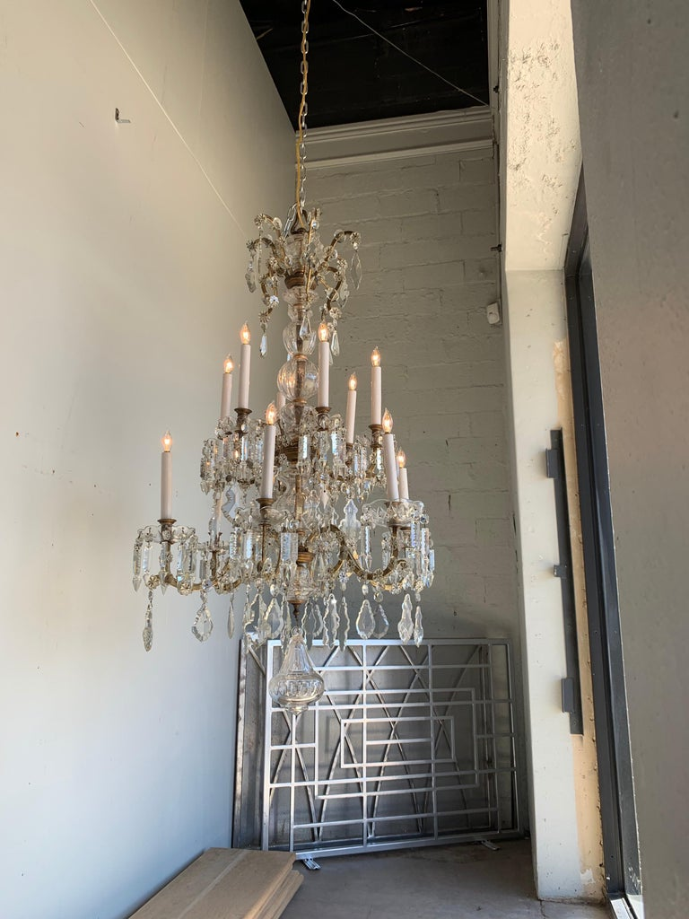 Elegant 19th century French crystal chandelier with 12-light. Covered in crystals, prisms and beads. A Classic beauty!
