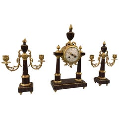 19th Century French 3-Piece Rouge Marble and Bronze Clock Set