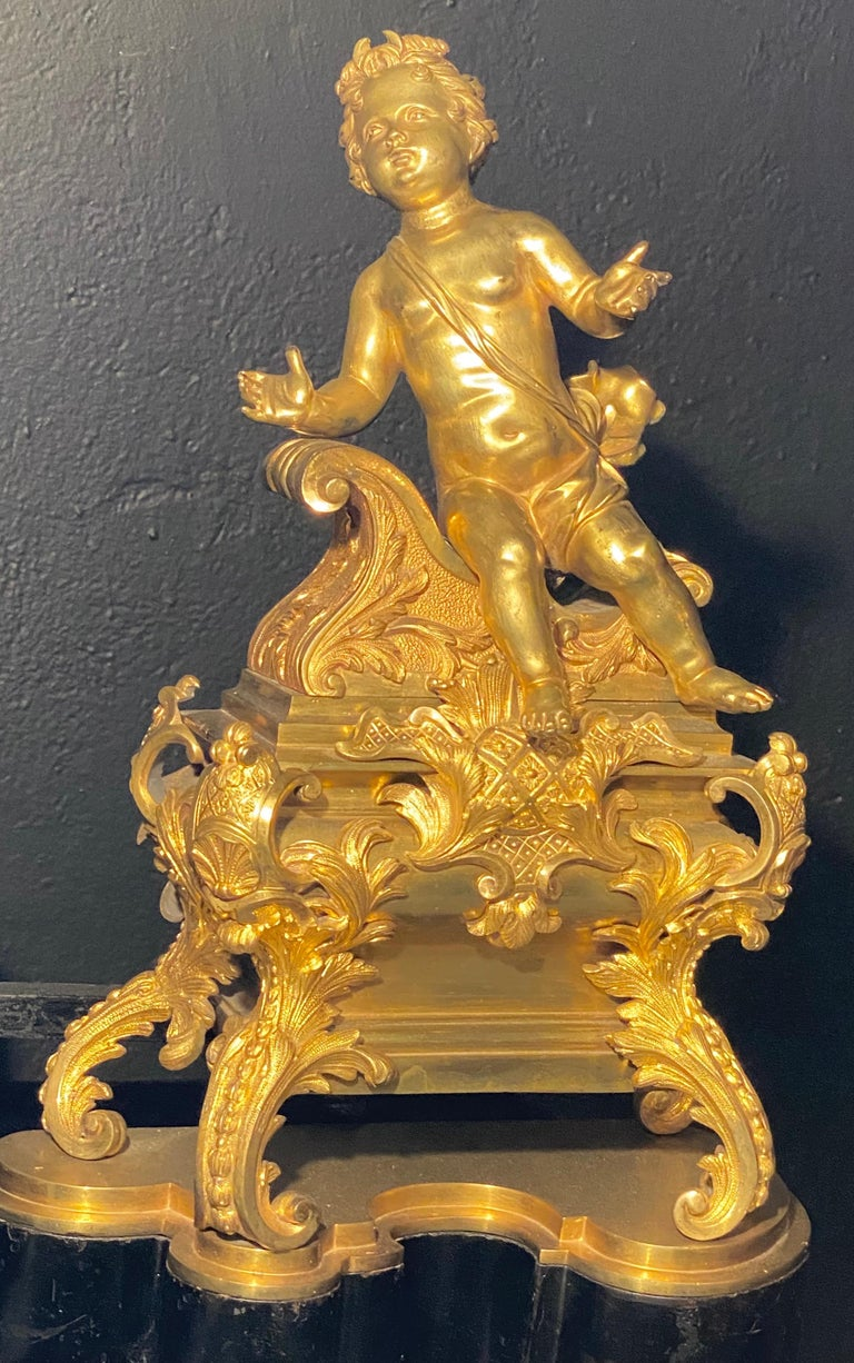 Gilt 19th Century French Andirons, Opposing Cherubs on Stands in Doré Bronze For Sale