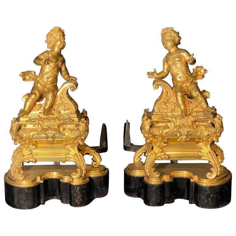 19th Century French Andirons, Opposing Cherubs on Stands in Doré Bronze For Sale
