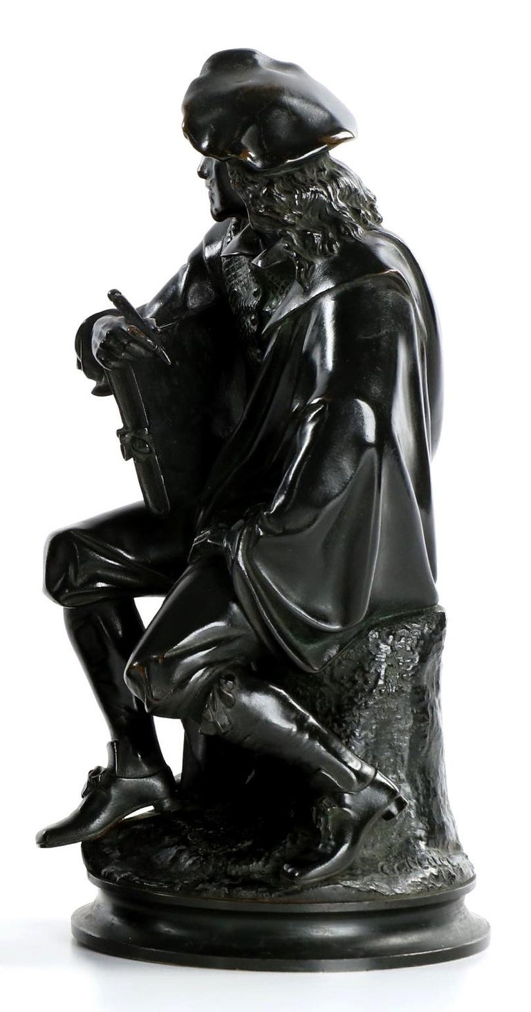 A very fine cabinet bronze sculpture depicting the seated figure of Rembrandt, it is inordinately well detailed in light of the small profile. The facial features are perfectly represented with a crisp nose and a firm brow over finely chiseled