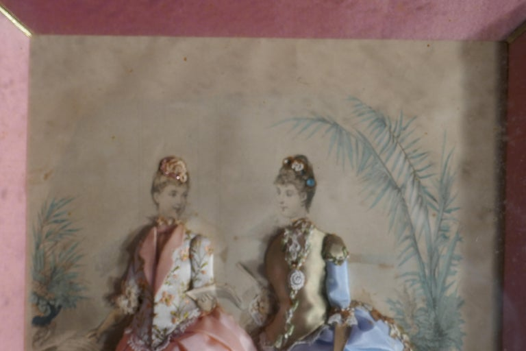 19th Century French Appliqué Framed Fashion Salesman Samples  These charming pieces are dated 1876, they are advertisements for illustrated Magazines which have been dressed in colours and fabrics for samples to be used by traveling sales men to