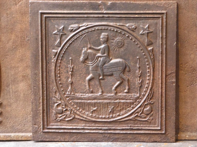 19th century French Art Nouveau fireback with a horse rider on a horse. The fireback has a natural brown patina. Upon request it can be made black / pewter.