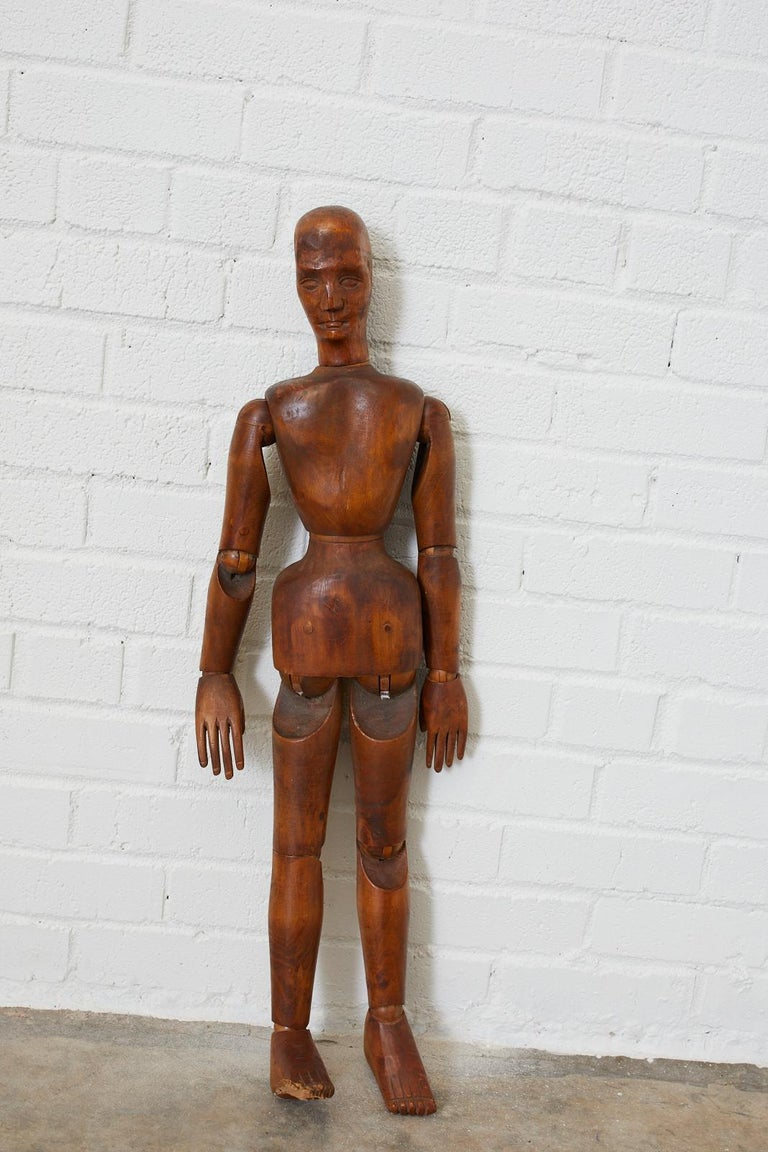 Large 19th century French artists mannequin handcrafted from beechwood. Features articulated joints and wood peg joinery. Beautifully carved face and intricate features. Lovely aged patina on the wood.