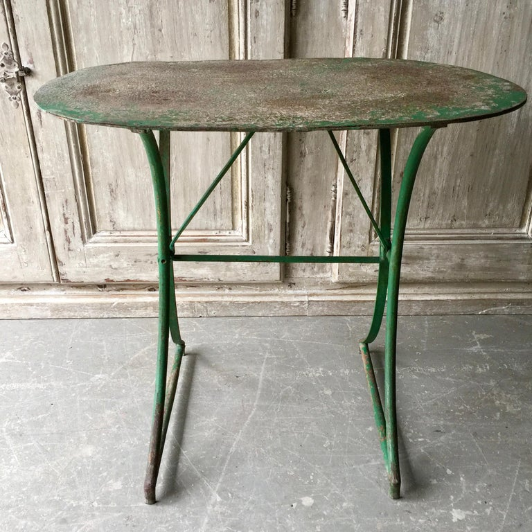 Charming French 19th century oval double pedestal base Bistro table in original worn rustic patina.