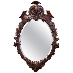 19th Century French Black Forest Carved Walnut and Beveled Glass Oval Mirror