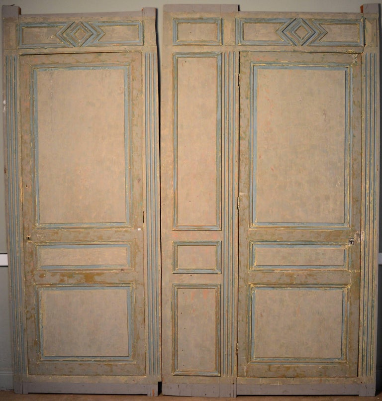 Mid-19th century French paneling with two doors. Scraped to reveal the wonderful old paint colors.