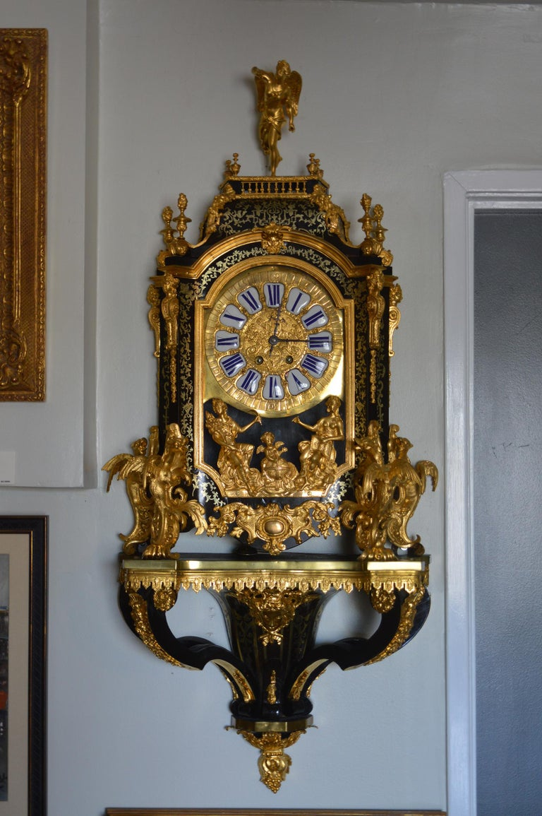 19th century French Boulle clock with pedestal. Working condition. Details of dragons at the base of the clock and Angel at the top.