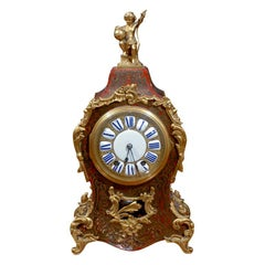 19th Century French Bronze Mounted Boule Mantle Clock with Porcelain Face