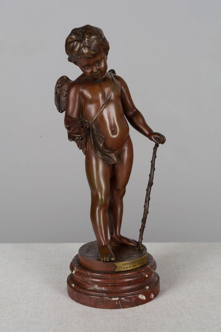 A finely cast patinated bronze sculpture of a cherub by Jean Didier Debut (French, 1824-1893) entitled