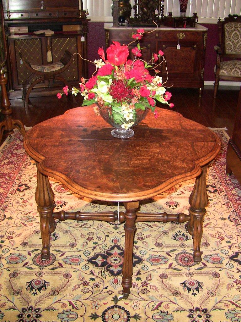 Late 19th century English drop-leaf table from the Mid-Victorian Era.  Made of gorgeous yellowish-brown walnut with a fantastic burl walnut table top. The top is a solid piece of burl walnut not veneered ......... the top is simply glorious!!  The