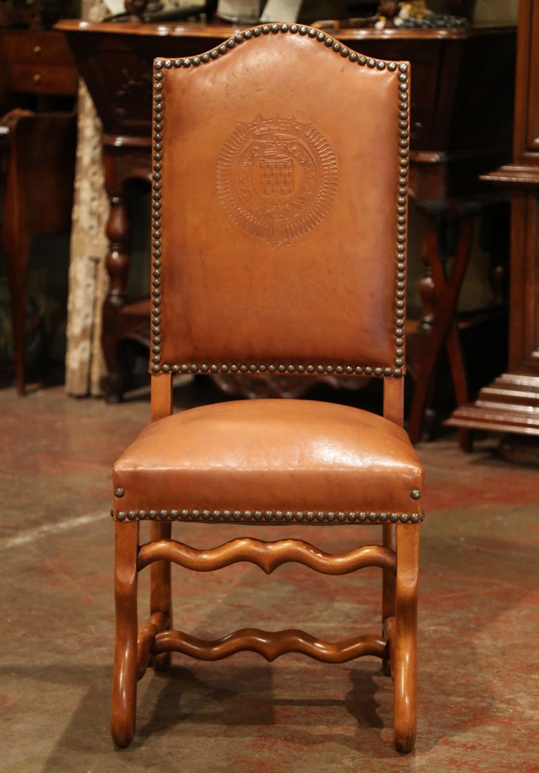 This elegant suite of antique chairs was crafted in France, circa 1880. Each of the eight side chair has a tall arched back and features carved