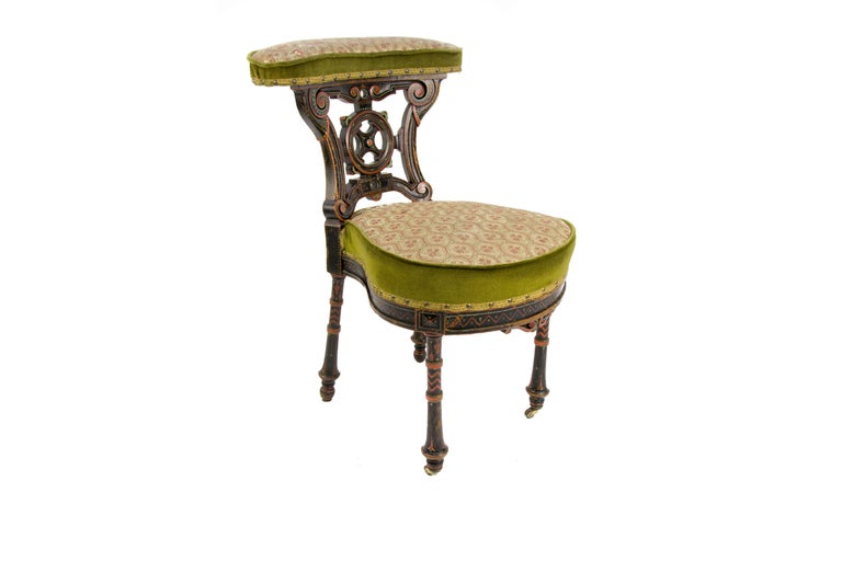 A very decorative, hand carved and painted French chair, smoking chair, called in France